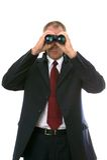 Businessman with binoculars. royalty free stock photos
