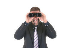 Businessman with binoculars Royalty Free Stock Photography