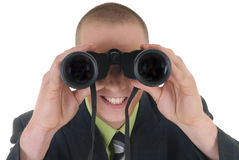 Businessman with binoculars Stock Photos