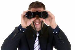 Businessman with binoculars Stock Photography