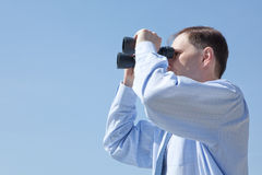 Businessman with binoculars Stock Images