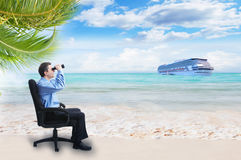 Businessman with binoculars on the beach. Royalty Free Stock Images