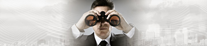 Businessman with binoculars. Business man with binoculars looking for job opportunity background Royalty Free Stock Image