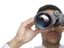 Businessman with binoculars closeup Stock Photography