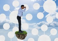 Businessman with binoculars on floating rock platform with interface mind maps in sky Royalty Free Stock Photo
