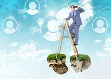 Businessman with binoculars on floating rock platforms and ladder with profiles interface in sky Stock Image