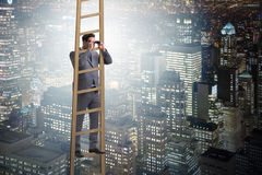 The businessman with binoculars looking into future Royalty Free Stock Image