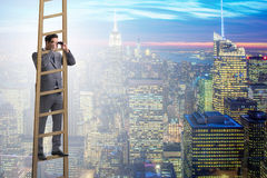 The businessman with binoculars looking into future Stock Photo