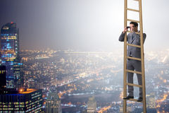The businessman with binoculars looking into future Royalty Free Stock Images