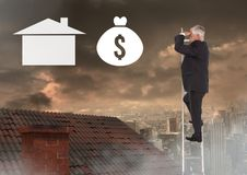 Businessman with binoculars looking at money icons over property ladder on roof Royalty Free Stock Photo