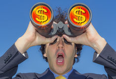 Businessman with binoculars and money. Elegant businessman scanning the horizon in search of money, dollars and money cash