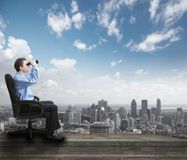 Businessman with binoculars. Stock Photo