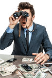 Businessman with binoculars. Photos of modern businessman at the workplace Royalty Free Stock Image
