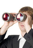 Businessman with binoculars searching. For something isolated over white Royalty Free Stock Photos