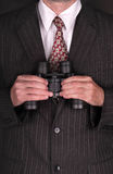 Businessman with binoculars Royalty Free Stock Photos