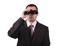 Businessman with binoculars Royalty Free Stock Photos