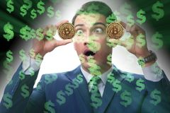 The businessman in bitcoin price increase concept. Businessman in bitcoin price increase concept Stock Photo