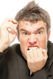 Businessman biting fingers Stock Photography