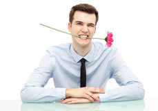 Businessman biting flower Royalty Free Stock Photography