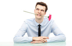 Businessman biting flower Stock Image