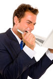 Businessman biting a laptop Stock Photo