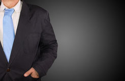 Businessman. On black background and copy space Stock Photos