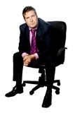 Businessman on black chair Royalty Free Stock Photography