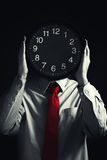 Businessman with black clock, deadline concept Royalty Free Stock Image