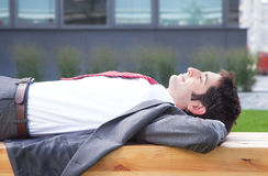 Businessman with black hair relaxing outside Royalty Free Stock Images