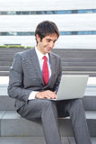 Businessman with black hair working with laptop Stock Photo