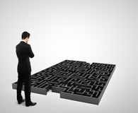 Businessman and  black labyrinth Royalty Free Stock Image