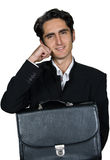 Businessman with black leathern case. Stock Photography