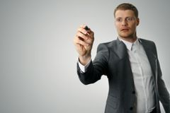Businessman with black marker in the hand Stock Photo