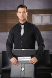 Businessman in black packing briefcase Royalty Free Stock Image