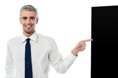 Businessman with black panel. Business man showing you something on his black board Stock Image