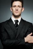 Businessman in black suit expressing confidence. Royalty Free Stock Photos