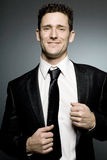Businessman in black suit expressing positivity. Royalty Free Stock Photography