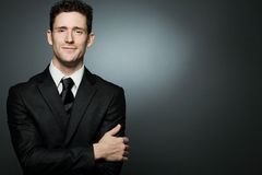 Businessman in black suit expressing positivity. Stock Image