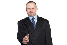 Businessman gives his hand to say hello Stock Photo