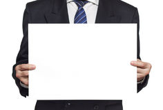 Businessman with a blank paper horisontal. Businessman in a black suit holding a blank paper in the hands isolated on white background horisontal Stock Photo