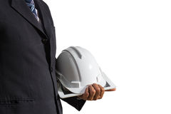 Businessman in black suit holding safety helmet and tablet Royalty Free Stock Images