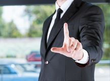 Businessman in black suit pointing with finger. Cropped view of businessman in black suit pointing with finger Stock Photos