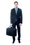 Businessman in black suit posing with bag Stock Photo