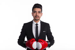 Businessman in black suit and red boxing gloves Stock Image