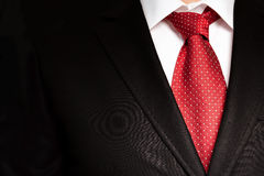 Businessman in a black suit with red tie Stock Photos