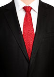 Businessman in a black suit with a red  tie Stock Images