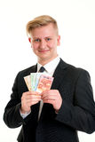 Businessman in black suit showing money Stock Photography