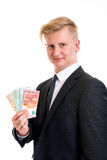 Businessman in black suit showing money Royalty Free Stock Photo