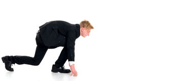 Businessman in black suit in start position Stock Image