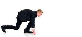 Businessman in black suit in start position. Young businessman in black suit in start position Stock Image